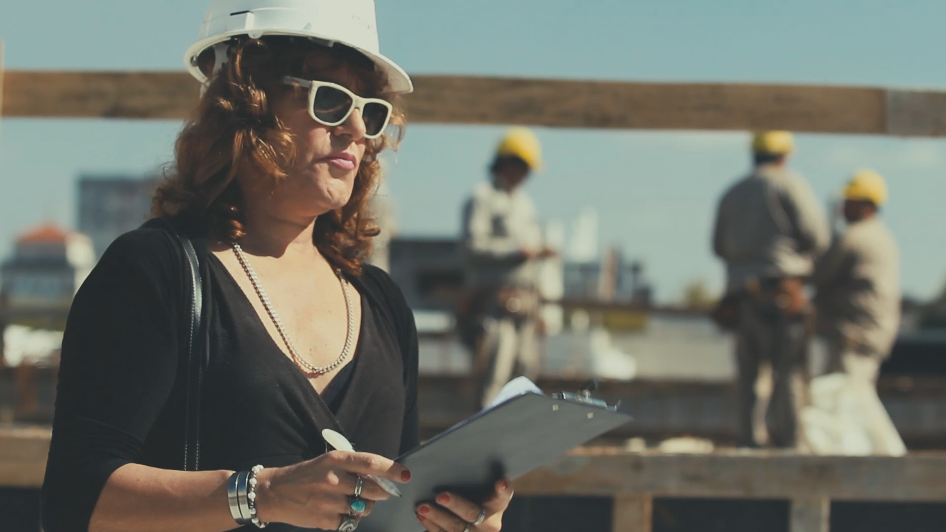 Canela wearing hardhat on construction site