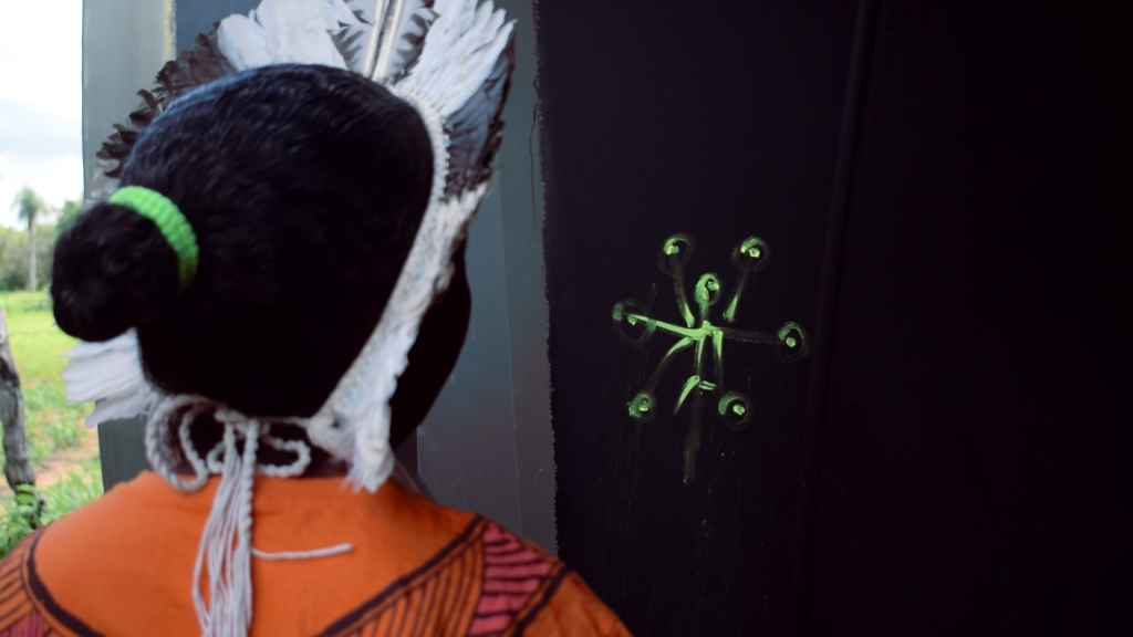 Image of young woman looking at a fluorescent drawing