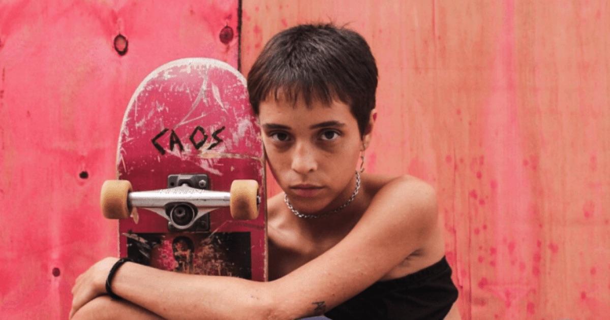 Short-haired girl with skateboard