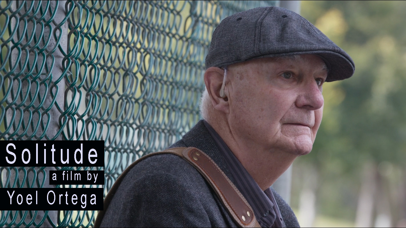 Image of older man with cap