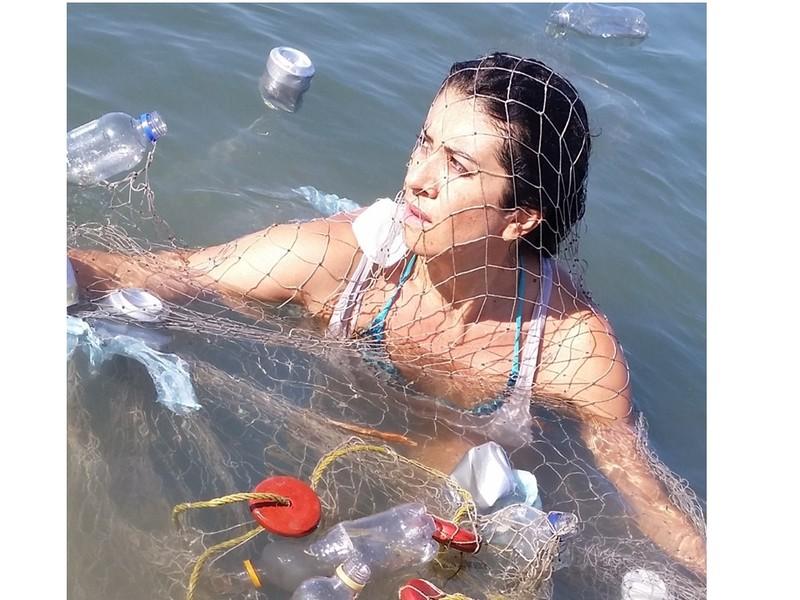 Woman swimming in fishing net